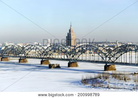 LATVIA, RIGA, JANUARY, 10, 2016 -  Panorama view of Riga city, capital of Latvia. View of the railway bridge over the Daugava river in winter, Riga, Latvia