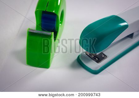 Close-up of stapler and cello tape on white background