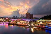 Colorful light building at night in Clarke Quay Singapore. Clarke Quay is a historical riverside quay in Singapore. poster