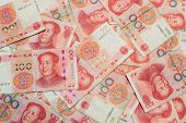 Many of one hundred Chinese yuan banknotes Chinese currency as background. poster