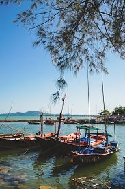 Thai small fishing boats have docked at fishing village at day time