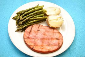 Ham Steak Served with Asparagus and Baked Potato