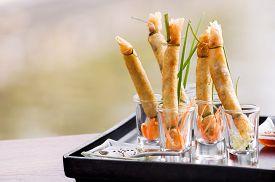 A la carte designed crispy deep-fried spring roll in mini glass serve for snack time