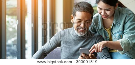 Smile Attractive Stylish Short Beard Mature Asian Man Using Smartphone With Young Woman. Daughter Te
