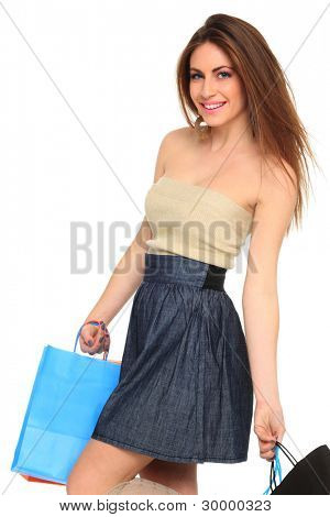 sexy shopping holding her purchase  girl isolated on white