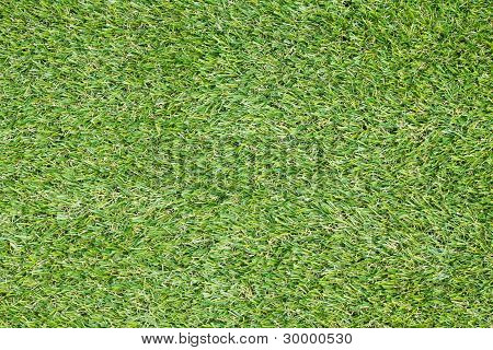 Background texture with fake grass in a public children playgrou
