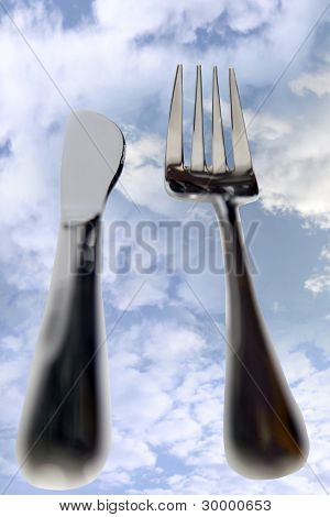 Dining Out Knife And Fork Isolated In Clouds