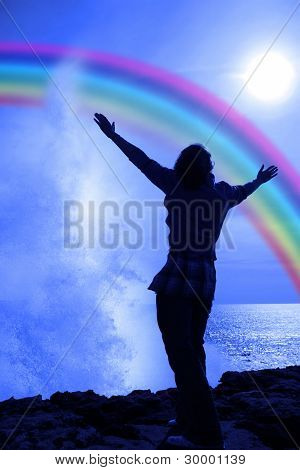 Silhouette Of Woman With Outstretched Arms In Awe At The Power Of Nature