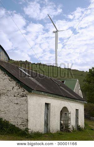 Windmill Above Abandoned Farm Sheds