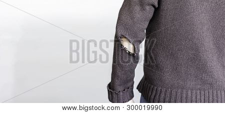 Man With Worn To Holes Fabric Sweater With Pipped Sleeve Close Up - Person Wearing Rubbed Old Shirt