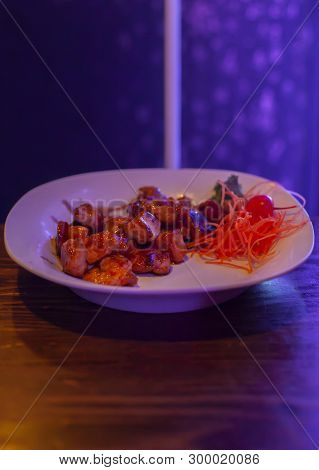 Grilled Shrimp And Shredded Carrots On A White Serving Plate