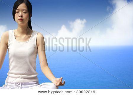 yoga woman with blue ocean background silen