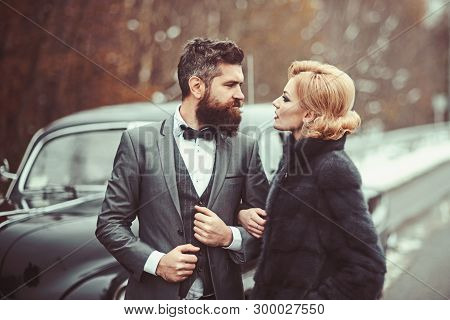 Couple In Love On Romantic Date. Bearded Man And Sexy Woman In Fur Coat. Retro Collection Car And Au