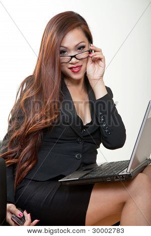 Pretty 20S Asian Businesswoman With A Laptop