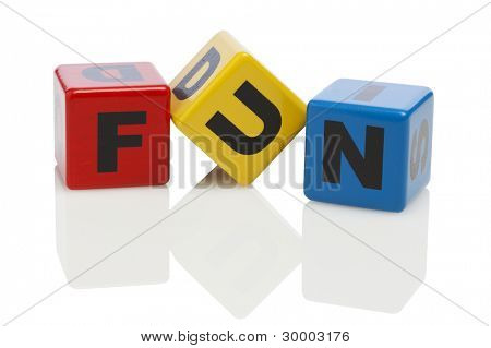 the word fun spelled with wooden alphabet building blocks, isolated on white
