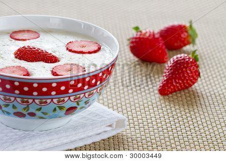 Breakfast porridge with strawberries