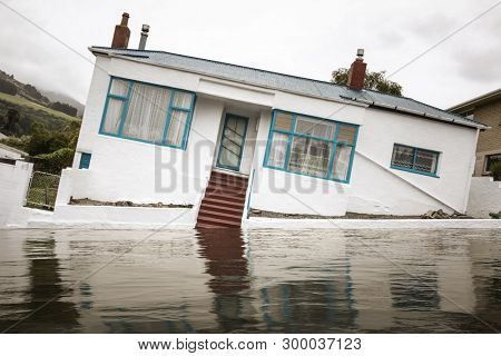 An image of a flooding with a crooked house