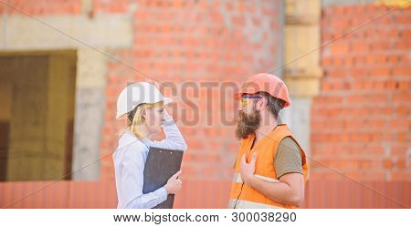 Construction Site Safety Inspection. Discuss Progress Project. Construction Project Inspecting. Safe