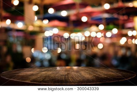 Selective Empty Wooden Table In Front Of Abstract Blurred Festive Light Background With Light Spots