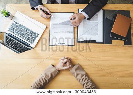Interviewer Or Board Reading A Resume During A Job Interview, Employer Interviewing A Young Female J