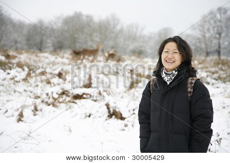 Smiling East Asian Woman In Snow Covered Richmond Park