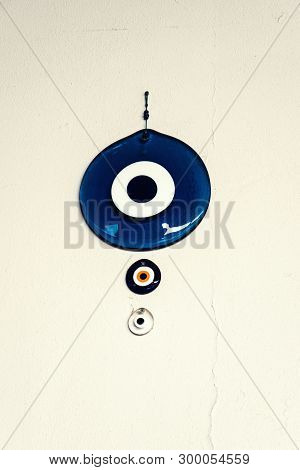 The Big Turkish Eye Of The Prophet Hanging On The White Wall As A Decoration To Deter Bad Luck