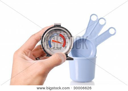 Hand Holding A Cooking Thermometer