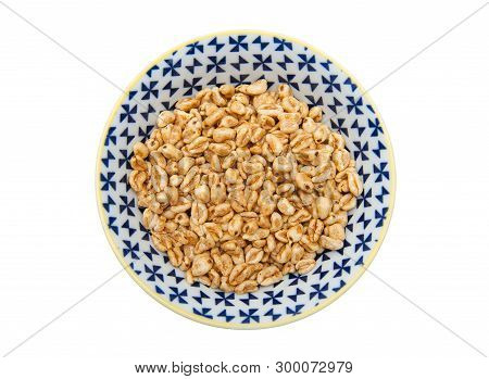 Puffed Wheat In Bowl Isolated On White Background