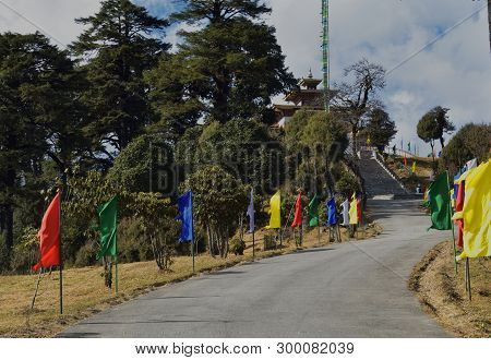 Road And Stairs Decorated With Colored Flags To Druk Wangyel Monastery From Dochala Pass In Bhutan