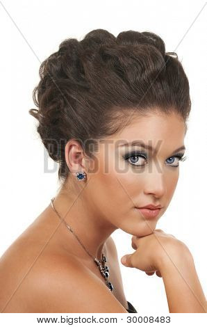 Young woman with beautiful make up, hairdo and sapphire  diamond jewelry