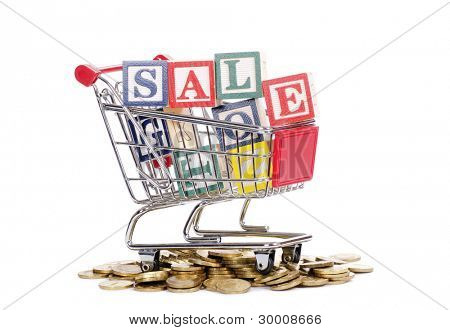 The coins, shopping cart and word SALE