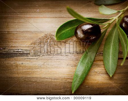 Olives over Wood Background