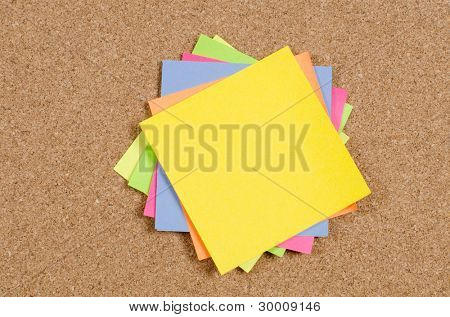collection of various note papers on corkboard