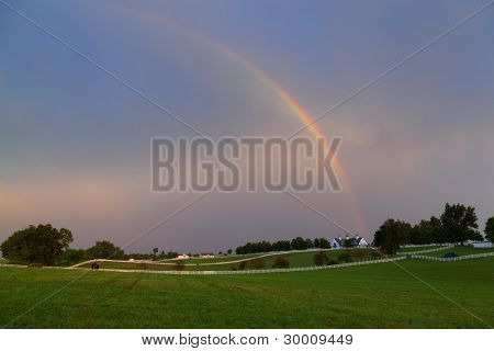 Rainbow over a horse farm