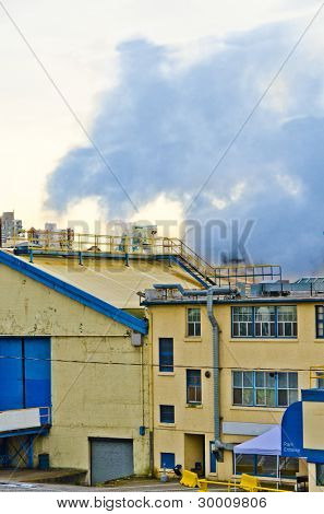 Power plants generating smokes at overcast weather.