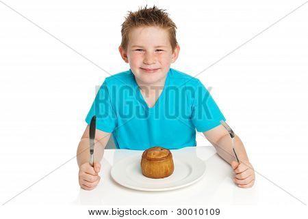Boy eating pie.