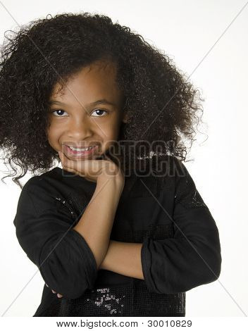 Adorable smiling little girl with gorgeous curly hair