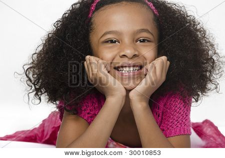 Adorable cute little girl with curly hair and big bright happy smiling expression