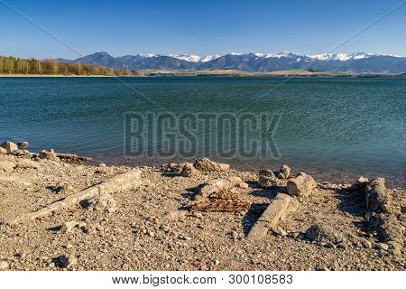Flooded Village And Water Reservoir Liptovska Mara, Slovakia. Low Tatras Mountains At Background