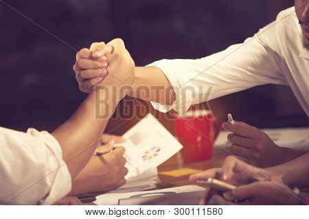 Business People Shaking Hands, Finishing Up A Meeting Handshake Business Concept.vintage Color