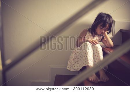 Sad Child From This Father And Mother Arguing, Family Negative Concept.vintage Color