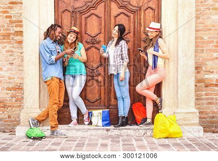 Multiracial Friends Using Mobile Phone Standing Outdoor - Group Of Happy Teenage Looking Cellphone I