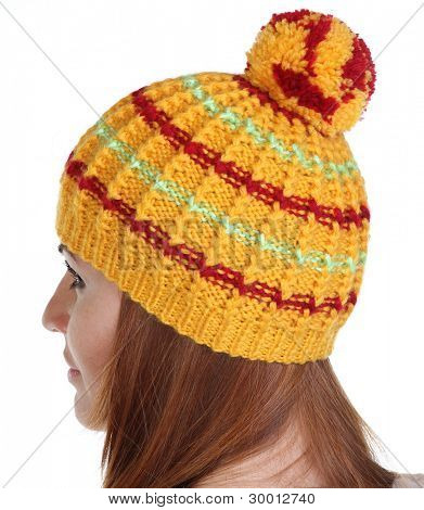 young happy woman in a knitted hat