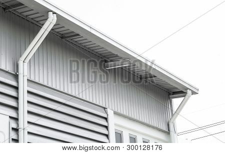 Factory Warehouse And Industrial Concept - Wall And Roof Of Factory Or Warehouse Building In Industr