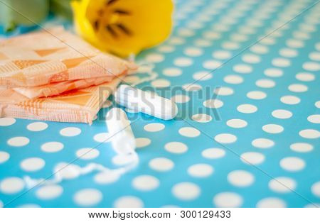 Menstrual Tampons And Pads On A Blue Background. Menstruation Cycle. Hygiene And Protection.
