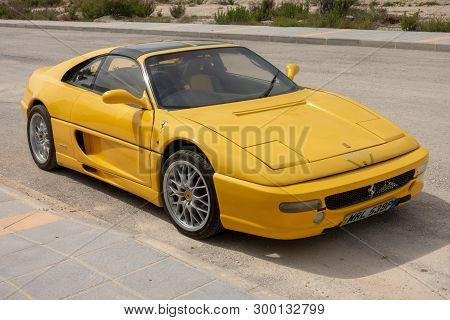 Torrevieja, Alicante, Spain - May 8 2019 : Ferrari F355 Gts Motor Car In Yellow Parked On Road