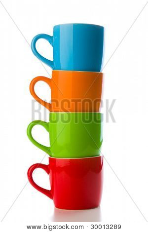 the pile of colorful ceramic mugs