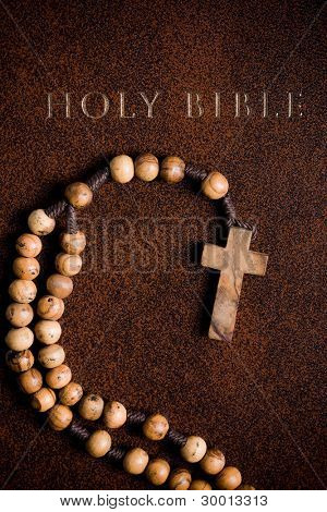 the wooden rosary on the Bible