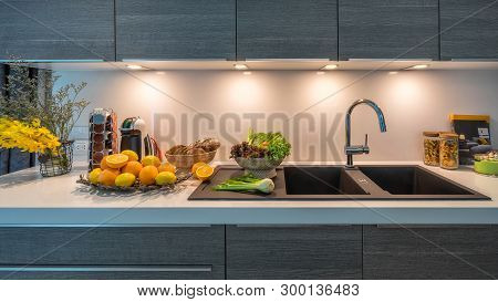 Kitchen Sink In Modern House Kitchen With Vegetables. Internal View Of A Modern Kitchen. Interior De