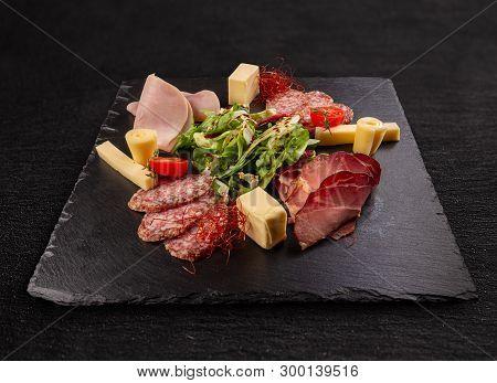 Meat Delicatessen On Black Slate Board, Studio Shot